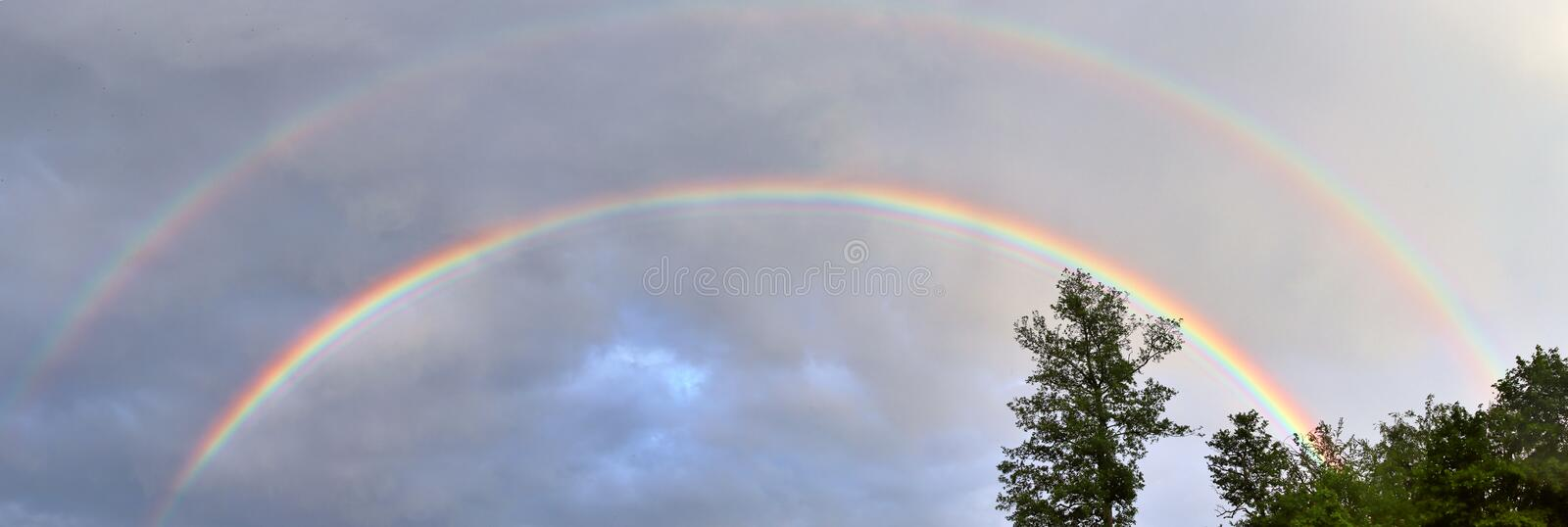 Stunning natural double rainbows plus supernumerary bows seen at a lake in northern germany royalty free stock image