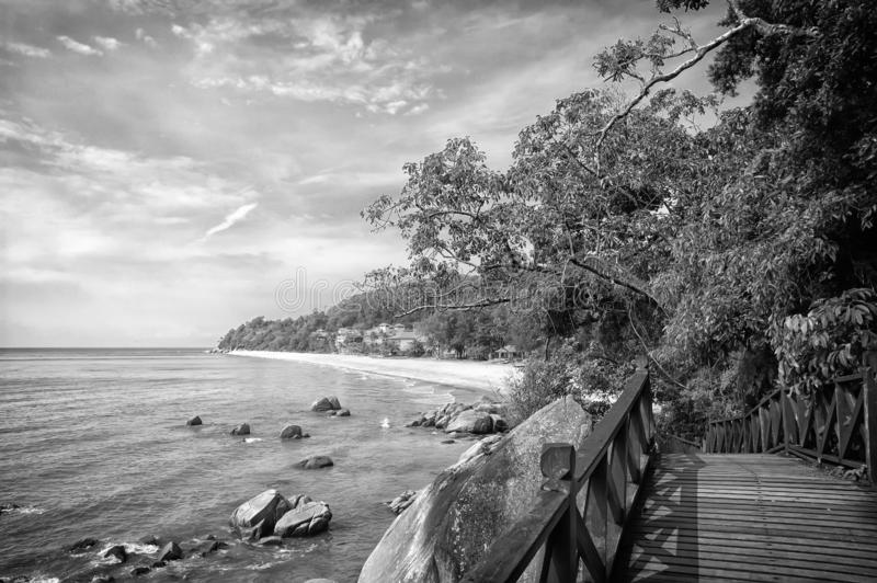 Stunning nature of Kuantan. Best Kuantan beach resorts famous for pristine nature. Coastline with tropic nature plants. Sand beaches. Bridge or wooden pier at royalty free stock photography