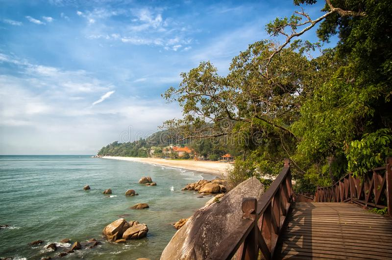 Stunning nature of Kuantan. Best Kuantan beach resorts famous for pristine nature. Coastline with tropic nature plants. Sand beaches. Bridge or wooden pier at royalty free stock image