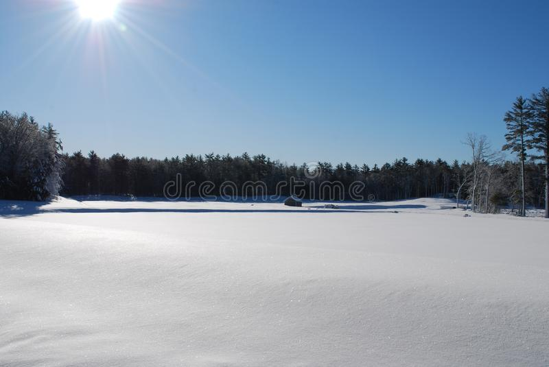 Stunning new england field covered in snow. The aftermath in new england after a winter blizzard royalty free stock photos