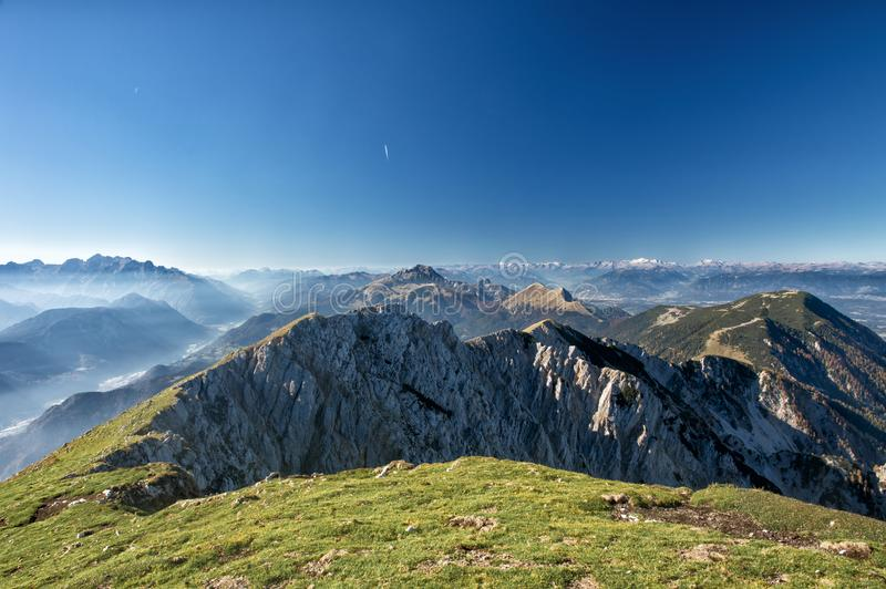 Stunning panorama view of a gorgeous Alpine mountain range on a sunny autumn day royalty free stock photos
