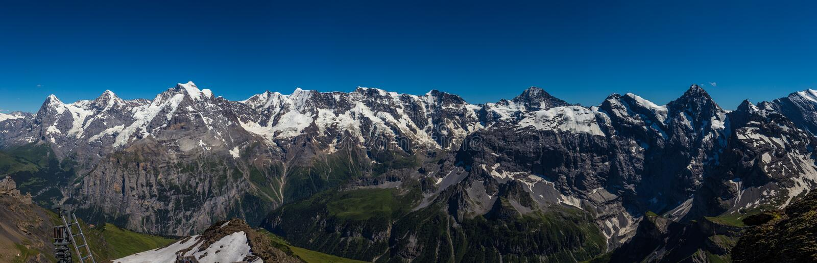 Stunning Panoramic view of Swiss Alps, Jungfrau mountain range from schilthorn, Murren, Switzerland royalty free stock photo