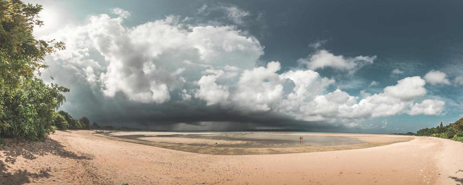 Stunning Paradise Beach Panorama of couple walking on beach while a huge storm is coming up, Neil Island, Andaman, India stock photos
