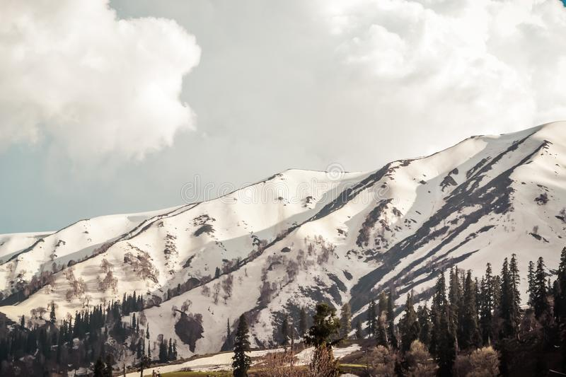 Stunning photograph of Kashmir also called `Paradise on Earth`, the most picturesque part of India, turns into a snowy wonderlan. D just before winter in Gulmarg stock images