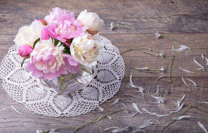 Stunning pink and white peonies on rustic wooden background. Copy space. Mother`s, Valentines, Women`s Wedding Day stock photos