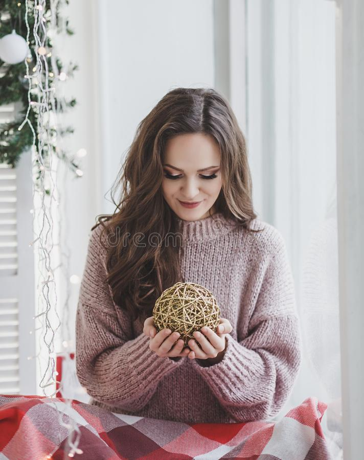 Woman with Christmas decorations. Stunning portrait of a woman with Christmas decorations stock photos