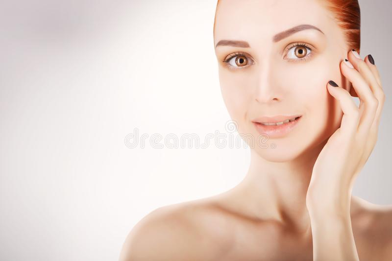 Stunning red haired woman skin health concept, grey background royalty free stock photography