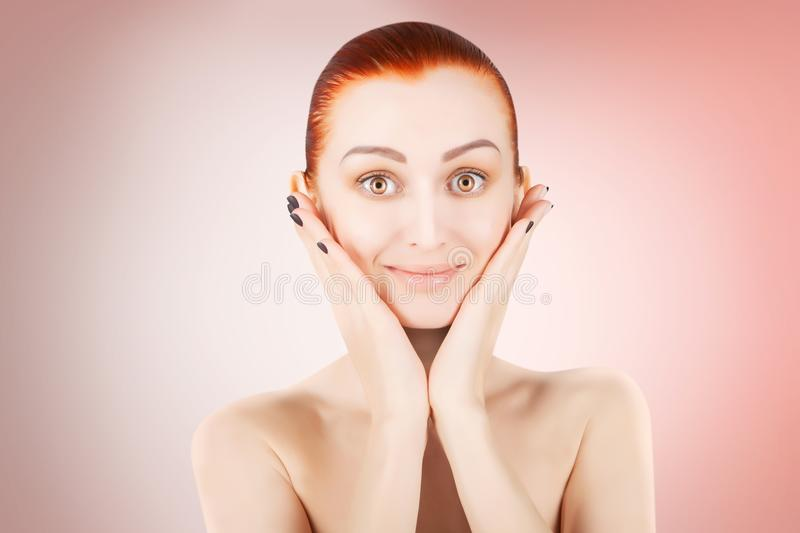 Stunning red haired woman skin health concept, pink background royalty free stock image