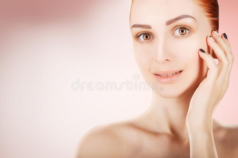 Stunning red haired woman skin health concept, pink background royalty free stock photos