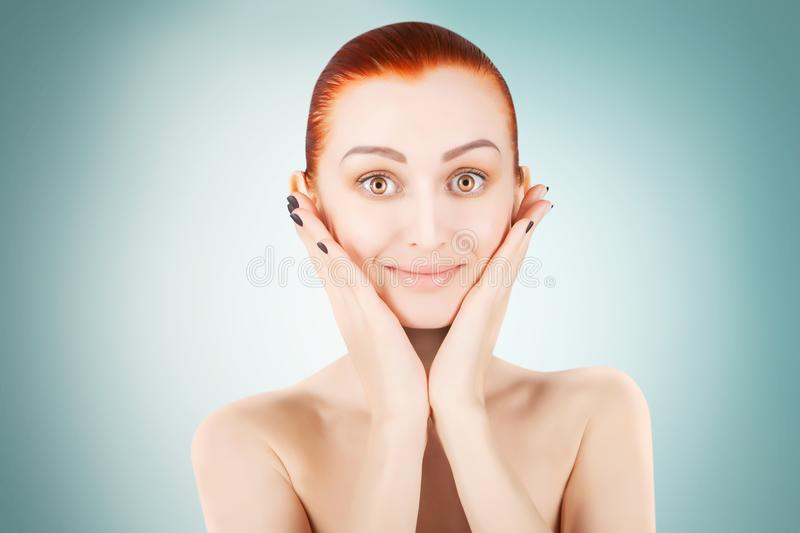 Stunning red haired woman skin health concept, blue background stock photo