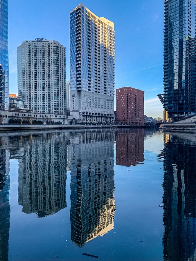 Stunning reflection of condos and raised drawbridge onto Chicaog River. During morning calm royalty free stock photography