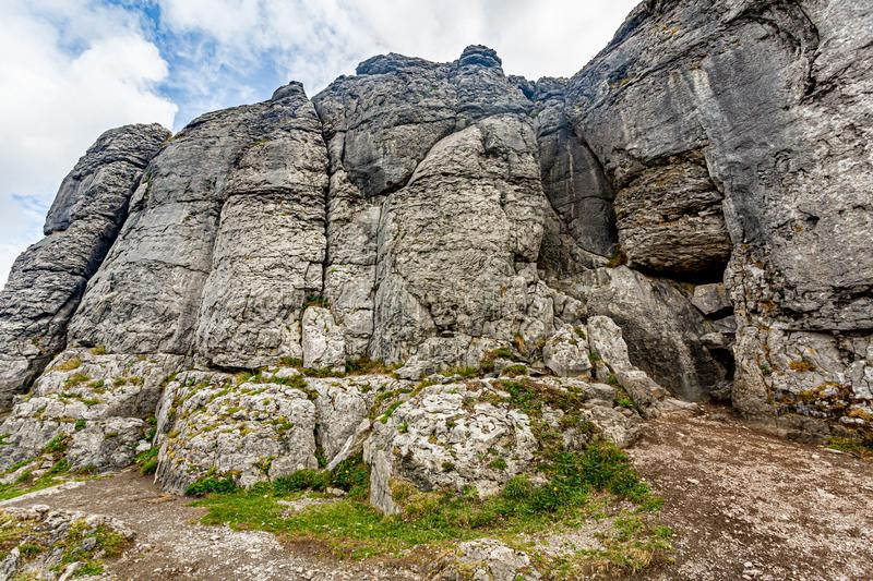 Stunning rocky limestone plateau landscape in the Burren in Caher valley. Geopark and Geosites, Wild Atlantic Way, Cloudy Spring Day in County Clare in Ireland royalty free stock images