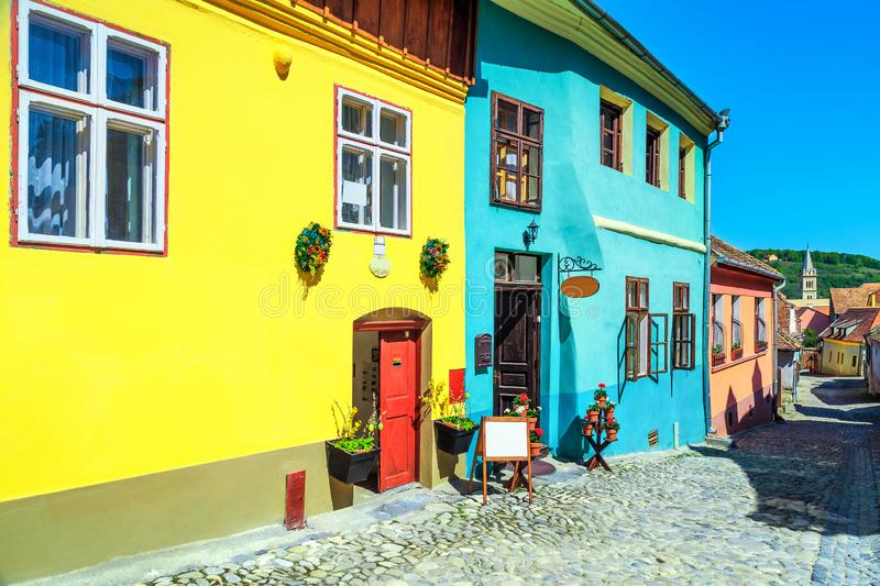Medieval saxon street with colorful buildings in Sighisoara, Transylvania, Romania royalty free stock images