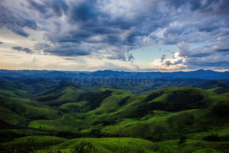 Green and blue mountains with a cloudy sky royalty free stock images