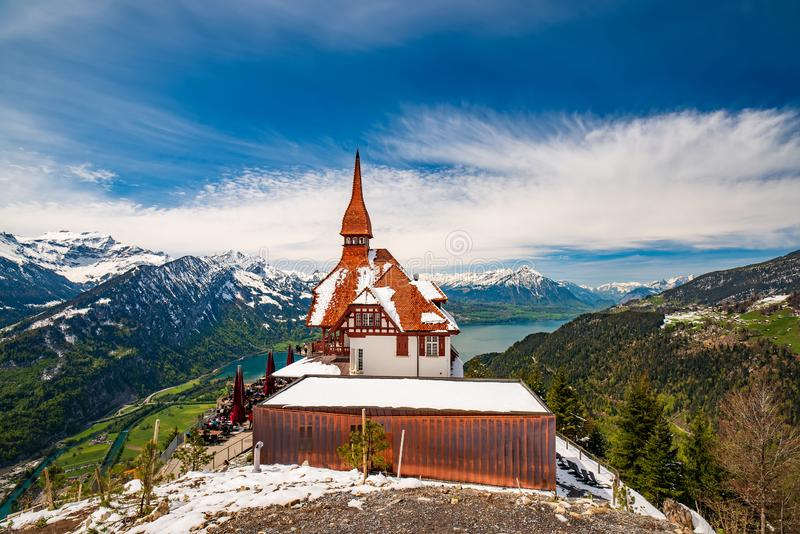 Stunning scenery with mountain hut on top Harder Kulm summit - popular tourist attraction over Interlaken, Switzerland. Stunning scenery with mountain hut on top royalty free stock photography
