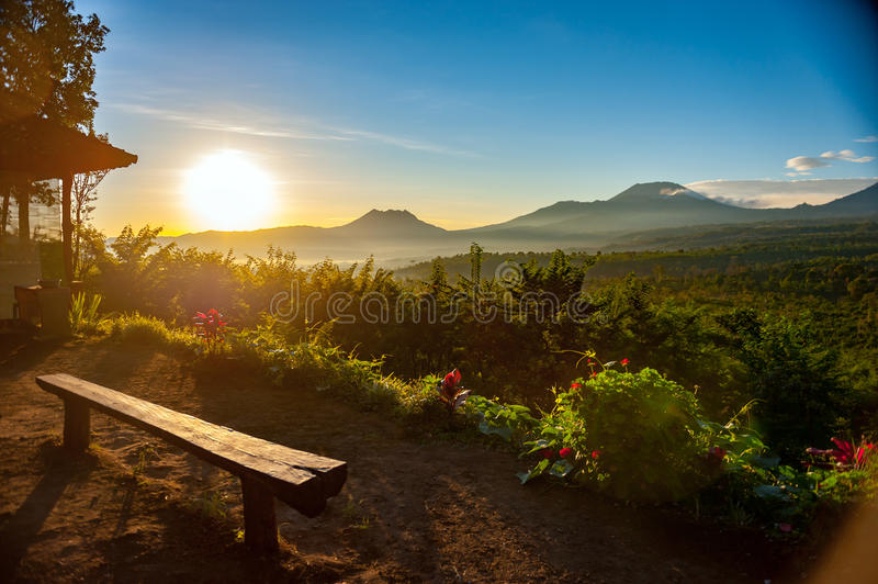 Stunning scenic with one lonely chair at Indonesia national park in sun rise royalty free stock image