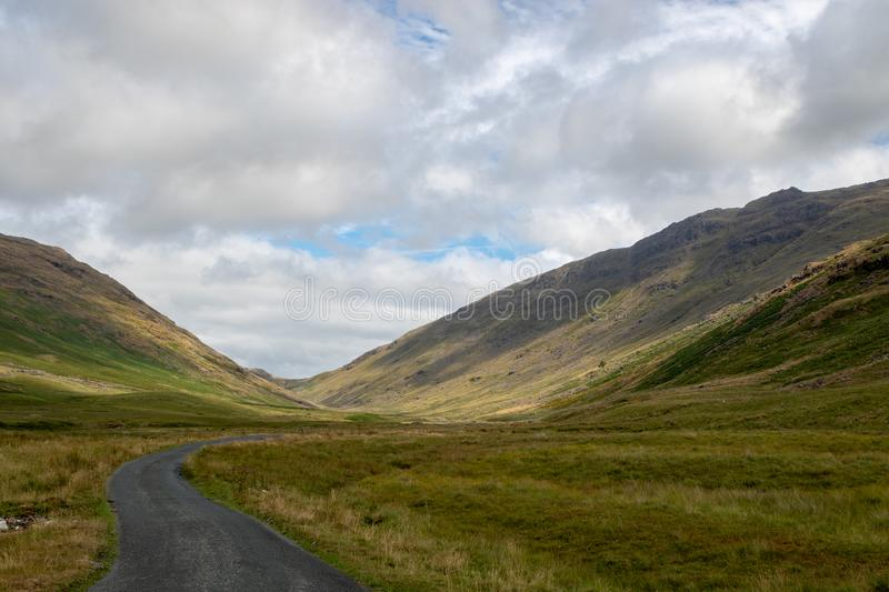 Stunning scenic view towards Wrynose Pass in Cumbria, Lake District National Park. One of the highest mountain passes in England royalty free stock photo