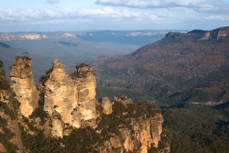 Stunning and scenic vista of Three Sisters outcrop, mountain ridge, plateau, forest covered valley in Blue Mountains National Park stock images