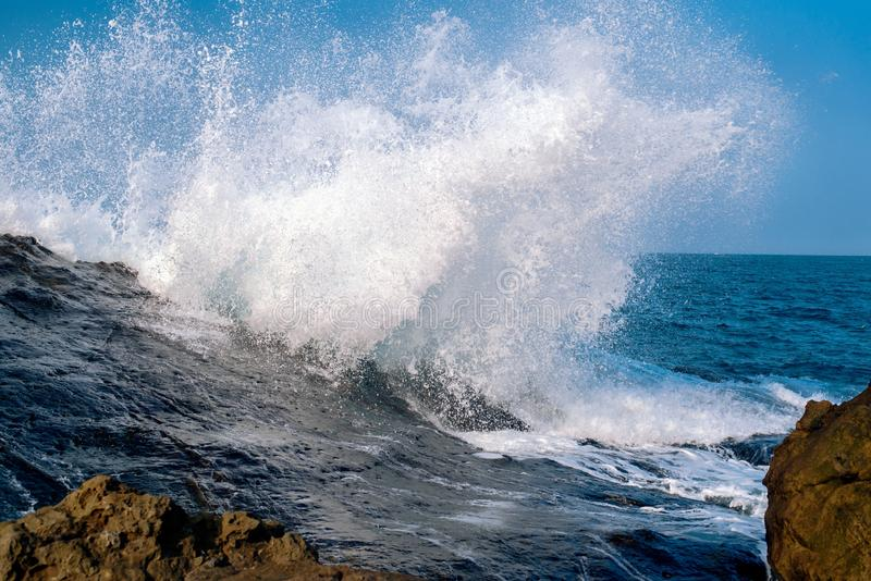 Stunning shot of crazy powerful sea waves crashing the rock formations - great for a cool background royalty free stock photos