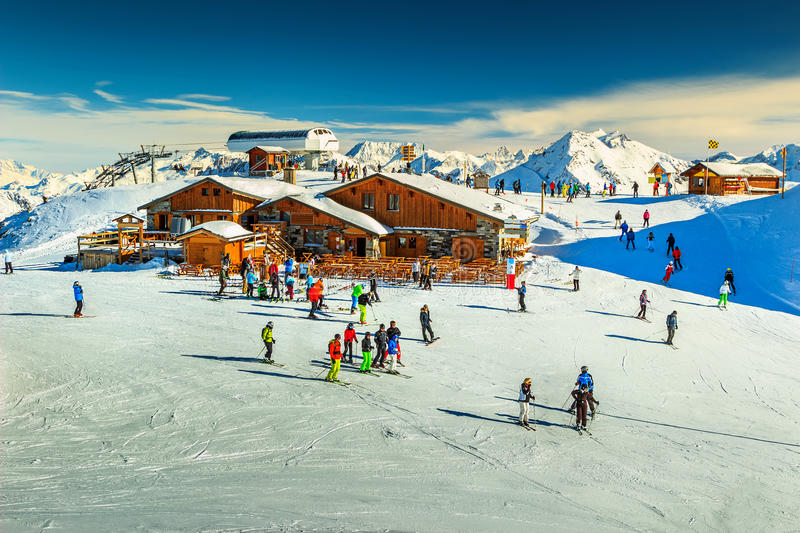 Stunning ski resort in the Alps,Les Menuires,France,Europe. Wooden chalets and ski slopes in the French Alps,Les 3 Vallees,Menuires,France,Europe stock images