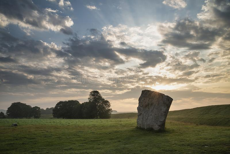 Stunning Summer sunrise landscape of Neolithic standing stones in English cluntryside with gorgeous light with slight background stock photo