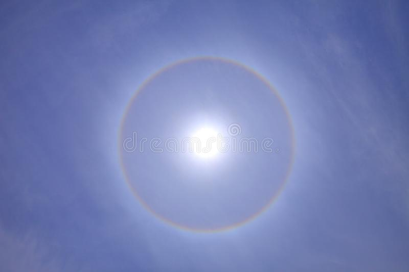Beautiful and stunning sun halo with deep blue sky on sunny day. Stunning sun halo with deep blue sky on sunny day stock photography