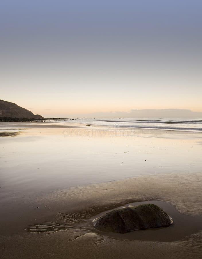 Stunning sunrise over sandy beach royalty free stock image