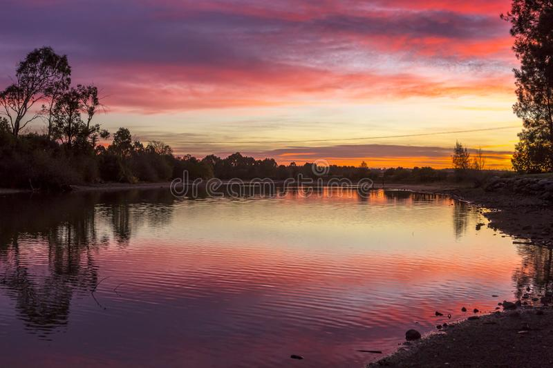 Stunning sunrise skies over rural Richmond Australia. Rural sunrise skies over tranquil lake and countryside at Richmond stock image