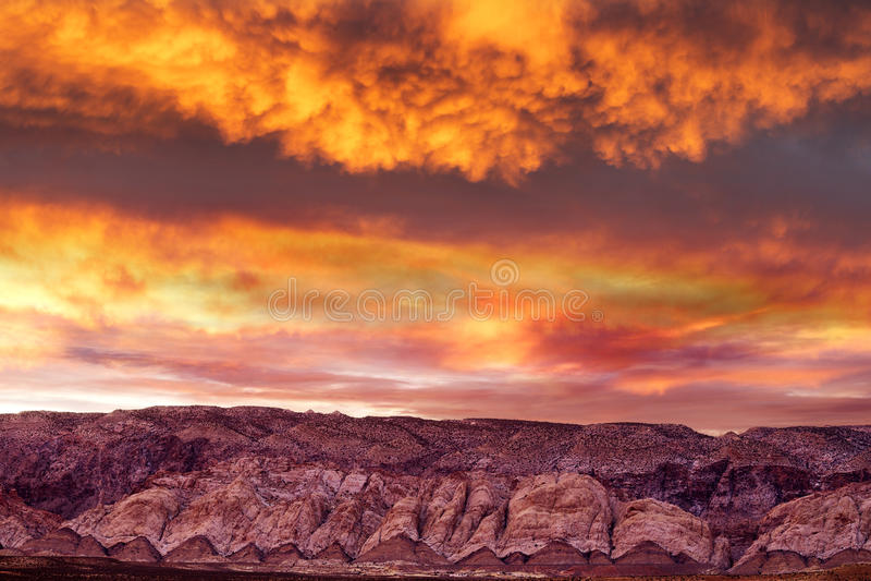 Stunning sunset in cloudy sky. On mountain range in Utah royalty free stock photos