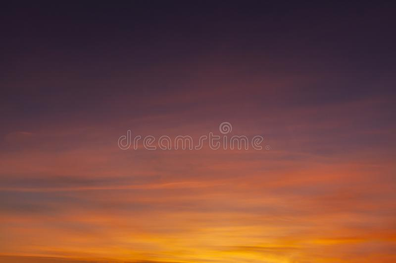 Stunning sunset colorful sky with wispy clouds. Stunning sunset sky with orange and red wispy clouds fading to dark skies above royalty free stock photos