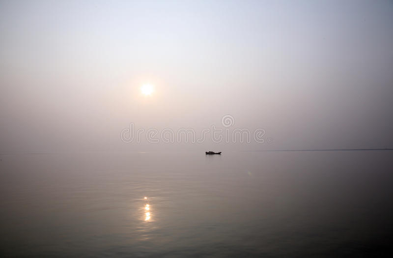 Stunning sunset looking over the holiest of rivers in India. A stunning sunset looking over the holiest of rivers in India. Ganges delta in Sundarbans, West royalty free stock photography