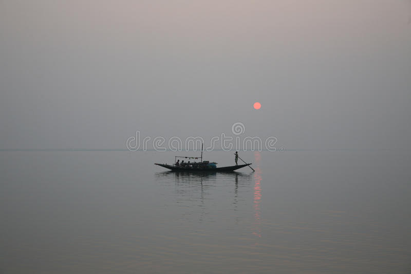 Stunning sunset looking over the holiest of rivers in India. A stunning sunset looking over the holiest of rivers in India. Ganges delta in Sundarbans, West stock image