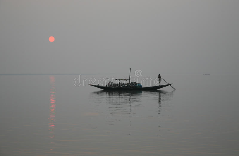 Stunning sunset looking over the holiest of rivers in India. A stunning sunset looking over the holiest of rivers in India. Ganges delta in Sundarbans, West stock photo