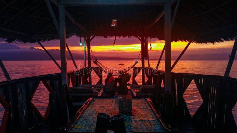 Stunning sunset over Samboan in Cebu Island in Philippines. Stunning orange sunset over cloudy sky at Samboan in Cebu Island in Philippines stock photography