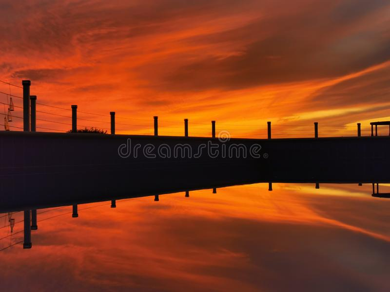 Stunning Sunset reflection on pool stock images