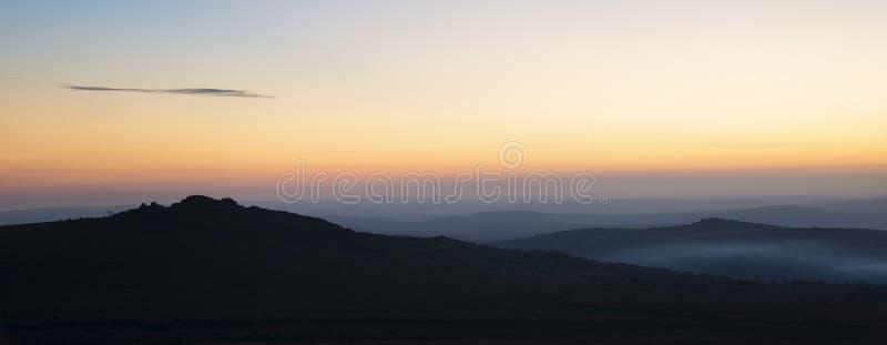 Stunning sunset silhouette landscape image of Foggintor in Dartmoor. Beautiful sunset silhouette landscape image of Foggintor in Dartmoor stock photo