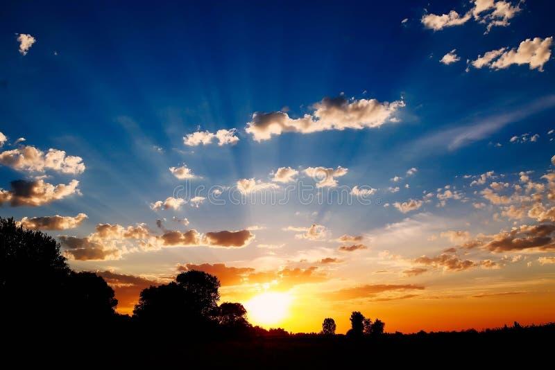 Stunning sunset. With sun rays, almost night, beautiful sky royalty free stock photos