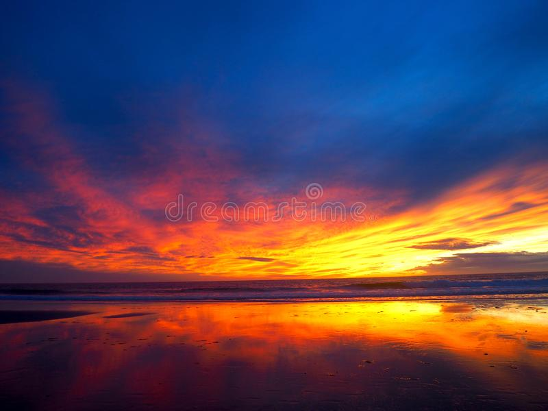 Incredible Sunset on the Pacific Ocean in Southern California. A stunning sunset with vibrant neon colors: pinks, purples, blues, and oranges taken at Grandview stock photography