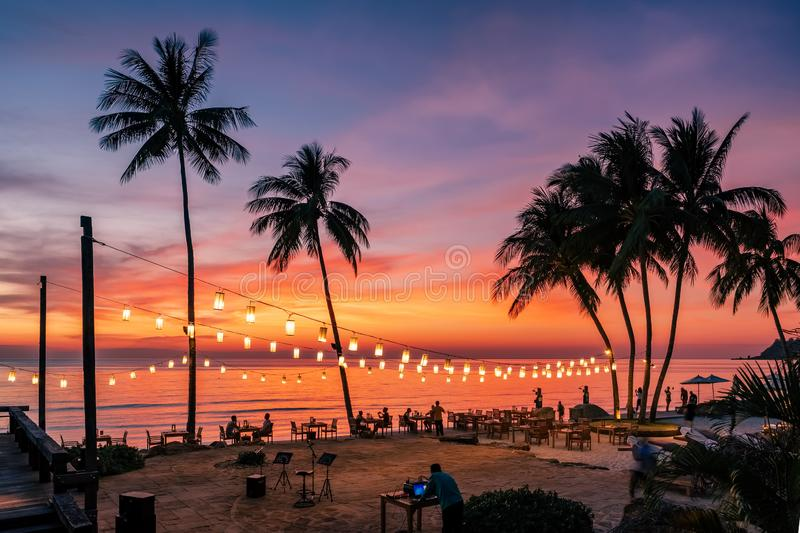 Stunning sunset view with palm trees reflecting in swimming pool in luxury island resort in Thailand stock image