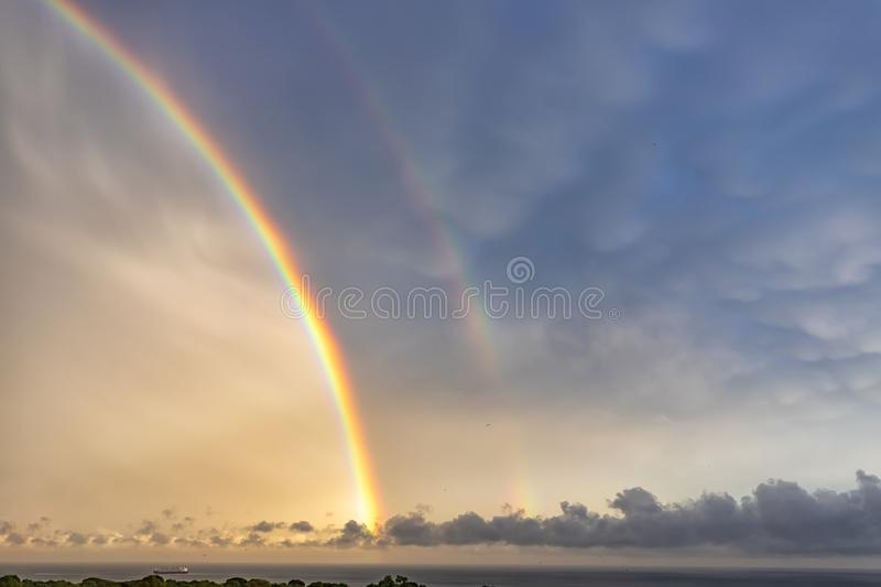 Stunning two big rainbows after the rain stock photography