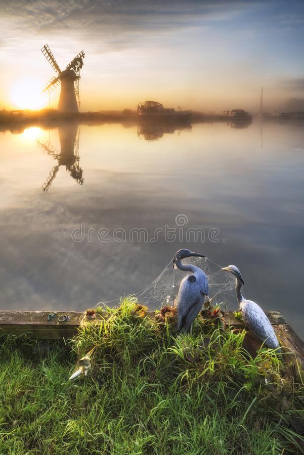 Stunning unrise landscape over foggy River Thurne looking toward. Sunrise landscape over foggy River Thurne looking towards Thurne Mill Windmill royalty free stock photography