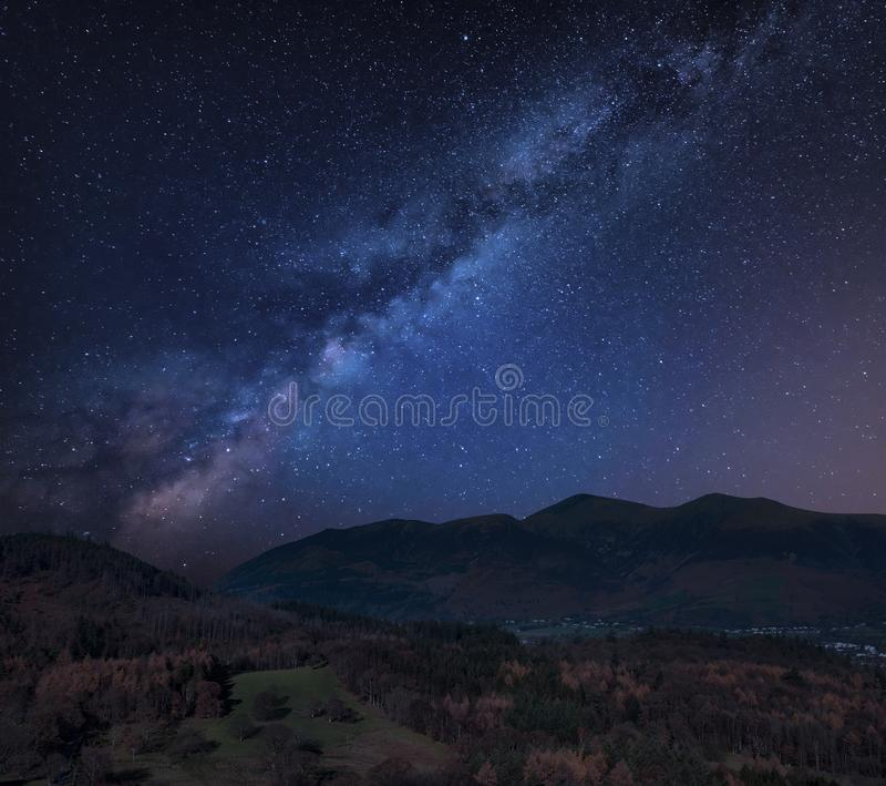 Stunning vibrant Milky Way composite image over Catbells near Derwentwater in the Lake District with vivid Fall colors all around royalty free stock image