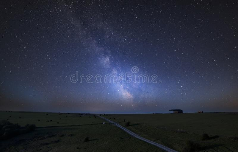 Vibrant Milky Way composite image over landscape of English countryside royalty free stock images