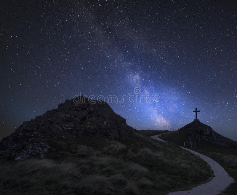 Vibrant Milky Way composite image over landscape of Ynys Llanddwyn Island with Twr Mawr lighthouse in background royalty free stock photography