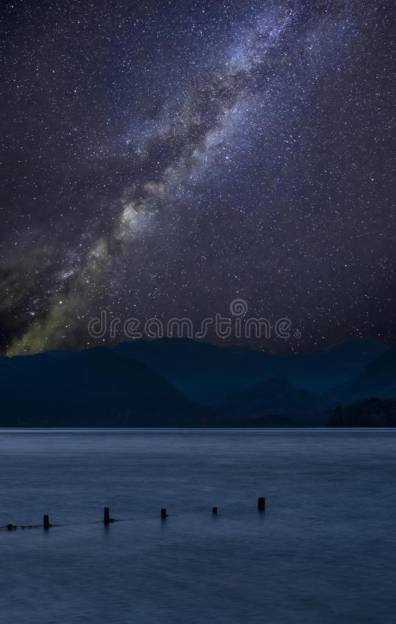 Stunning vibrant Milky Way composite landscape image over Derwent Water in Lake District during Autumn Fall sunrise with soft royalty free stock photos