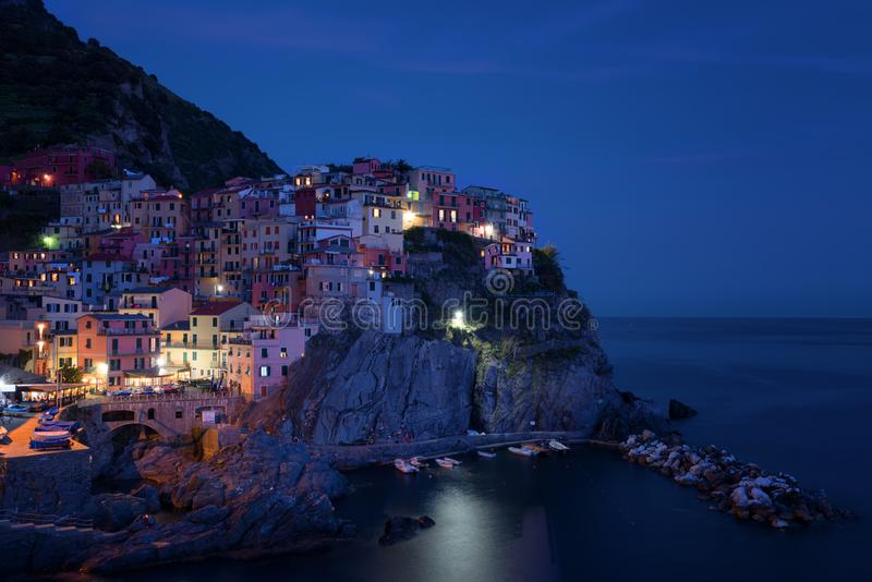 Stunning view of the beautiful and cozy village of Manarola in the Cinque Terre National Park at night. Liguria, Italy. royalty free stock photo
