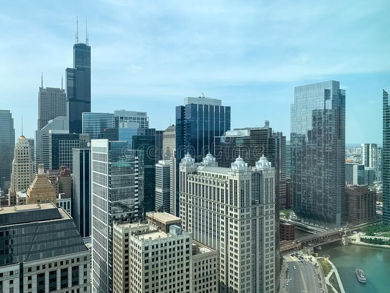 Stunning view of Chicago skyscapers and Chicago River with tourboats royalty free stock photo