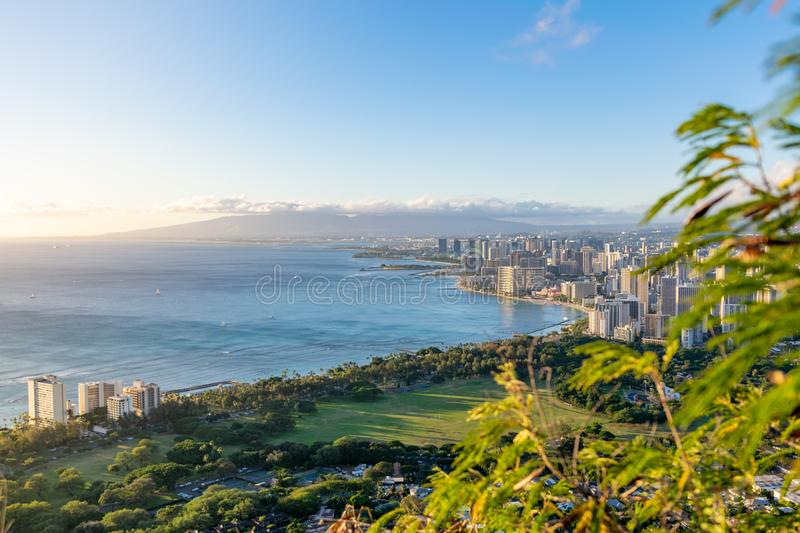 Stunning view of Honolulu and Waikiki Beach seen from the summit of Diamond Head Crater, Oahu, Hawaii. Beautiful evening just befo stock image