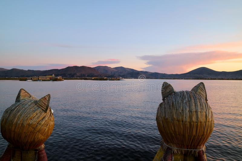 Stunning View of Lake Titicaca after Sunset as Seen from the Famous Totora Reed Boat with a Pair of Puma Shaped Prows, Puno, Peru stock photo