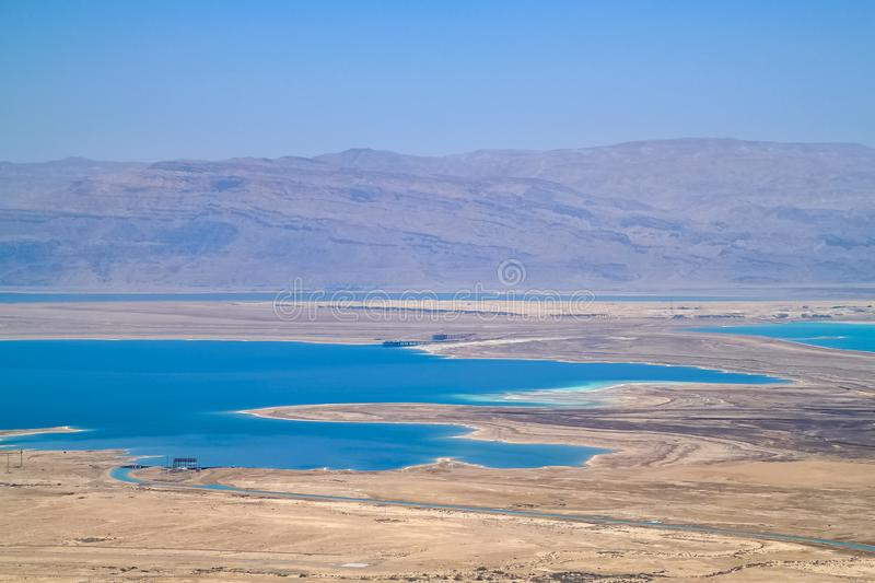 Stunning view of salt deposits and turquoise water of the Dead Sea and Judean Desert in Israel stock photography